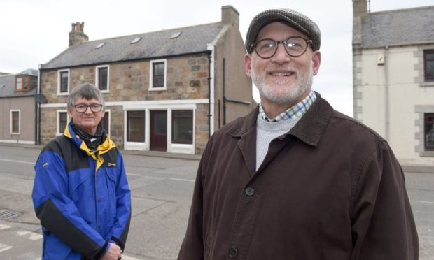 Portgordon Community Harbour Group vice-chairman Colin Hanover and chairman Scott Sliter outside the former Richmond Arms.