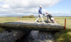 Nairn's Calum Scott on his home course on his way to shooting a four under par round.   Picture by Sandy McCook