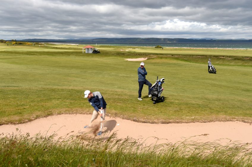 Gregor Graham, of Blairgowrie, in the bunker at the 17th. He just missed Tuesday's cut by three shots.