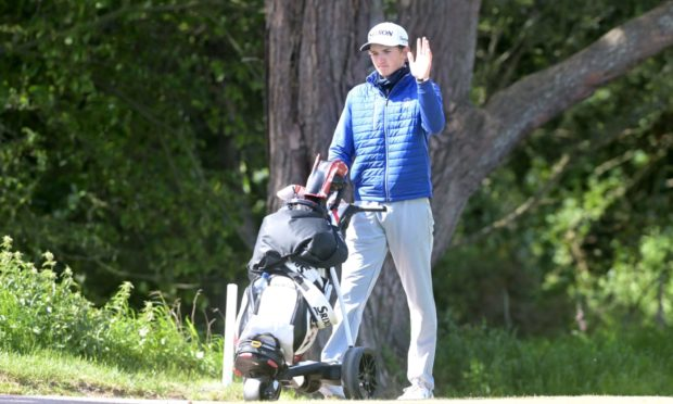 Nairn player Calum Scott on his home course on his way to shooting a four under par round. Picture by Sandy McCook