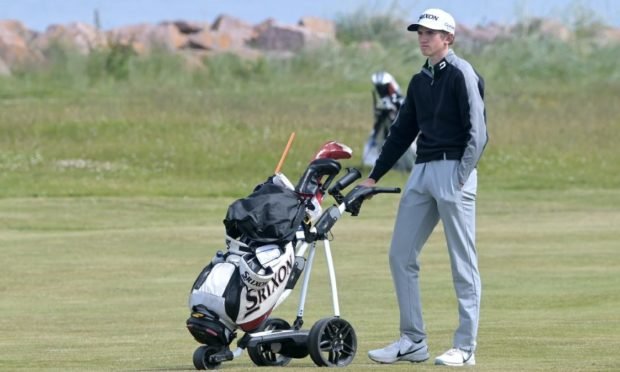 Calum Scott is into the last 16 of the match play stages of the Amateur Championship on his home course of Nairn.  Picture by Sandy McCook