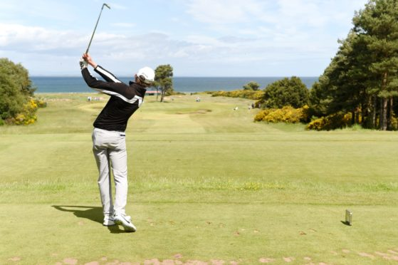 Calum Scott drives on the 14th. Pictures by Sandy McCook