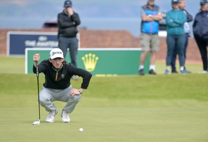 Calum Scott closely misses a putt on the 18th to square the match and go to the 19th hole against Iceland's Hlynur Bergsson.