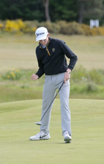 A putt and then the celebrations on the 19th hole as Calum Scott of Nairn beats Harley Smith, of The Rayleigh Club, in Thursday's third round tie.