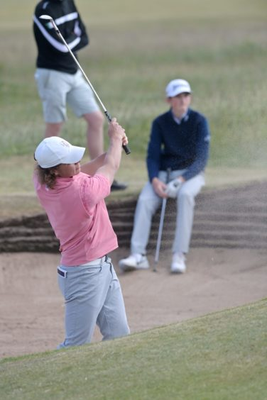 Calum Scott can only watch as James Ashfield comes out of the bunker in one on the eighth.