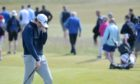 A disappointed Calum Scott makes his way off the 16th green having had a poor putt. Pictures by Sandy McCook