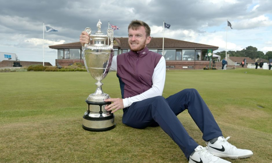 Laird Shepherd gets his hands on the Amateur Championship trophy after his stunning comeback triumph.