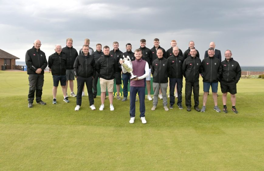 Champion Laird Shepherd with staff from Nairn Golf Club.