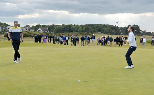 The moment on the 38th hole when Laird Shepherd, right, became the Amateur Championship winner.  Picture by Sandy McCook