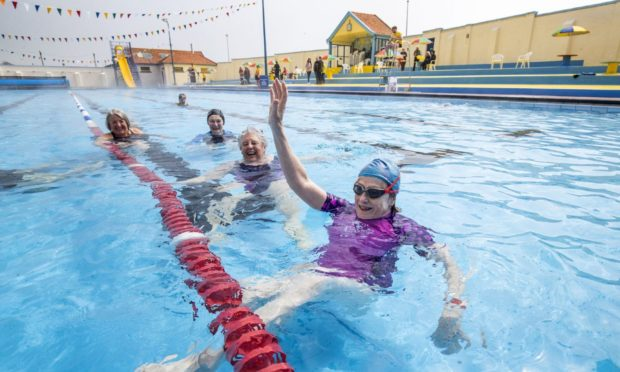 Swimmers at the Stonehaven Open Air Pool in Aberdeenshire, which has reopened after lockdown restrictions were eased.