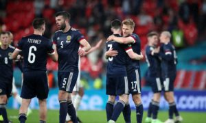 Scotland players embrace at the close of the game.
