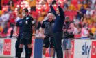 Derek Adams celebrates on the touchline towards the end of the Sky Bet League Two play-off final at Wembley where his Morecambe side defeated Newport 1-0. Picture by John Walton/PA Wire