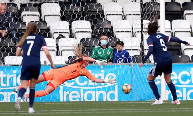 Scotland's Caroline Weir, right, scores the winning goal from the penalty spot