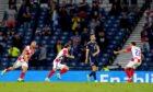 Croatia's Luka Modric (centre) celebrates scoring their side's second goal against Scotland.