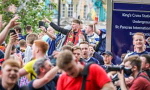 Scotland Fans arrive en masse off the train at London's Kings Cross Station ahead of the match between Scotland and England.