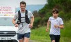 Steven Mackay (left) and his son Dylan during his 104-mile ultramarathon challenge.