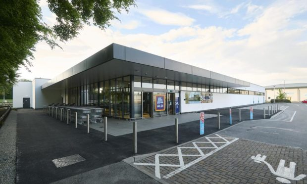 New Aldi store opens doors to Inverness customers following major revamp.