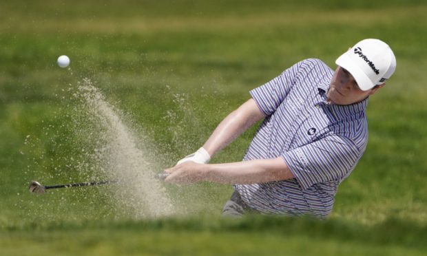 Robert MacIntyre plays a shot from a bunker on the first hole during the first round of the US Open.