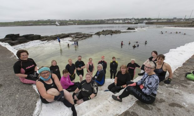 Some of Wick's Kool Water Swimmers, with organiser Patty Coghill, (left with the blue head band), at the North Baths.