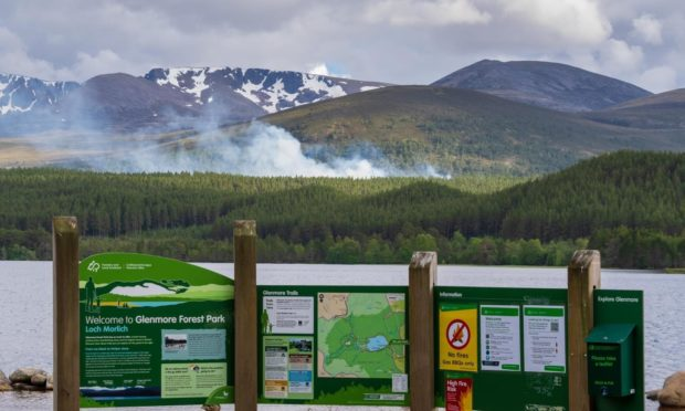 Smoke could be seen rising from the woodland near Loch Morlich
