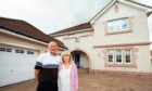 Scott and Wendy Robertson outside their stunning home in Grandholm Grove.