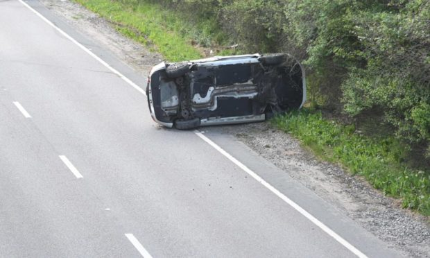 Overturned car on A96.