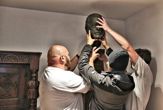 The bust of George MacLeod being reinstalled at the Abbey