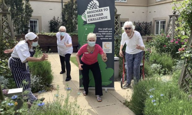 Picture shows: Braemar Lodge resident Joan Hills, far right, was among those who supported the Braemar-to-Braemar walking challenge. Joining her in the care home garden are, from left, Chef Frankie Collingwood, Clinical Lead Jackie Cash and Home Manager Alison Bremner.
