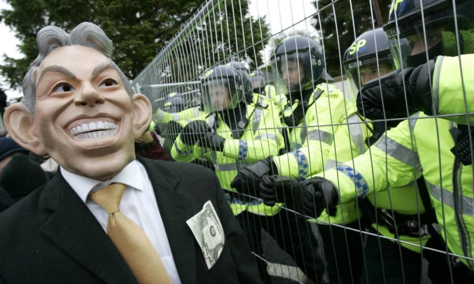 Protesters clash with riot police on the outskirts of Gleneagles Hotel at the G8 Summit in 2005.
