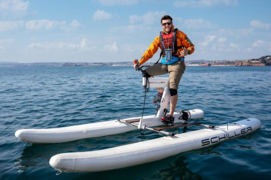 Pedal4Parks founder Isaac Kenyon on a water bike, which the team used to cross the Pentland Firth