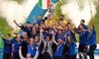 Captain Giorgio Chiellini lifts the trophy as Italy players and coach Robert Mancini celebrate  winning Euro 2020.