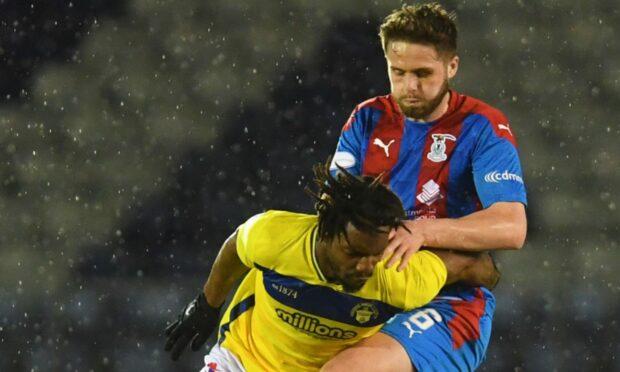 Caley Thistle defender Danny Devine puts pressure on Morton's Kazaiah Sterling.