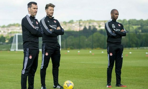 Management team - Boss Stephen Glass alongside coaches Allan Russell and Henry Apaloo.