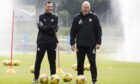 Aberdeen manager Stephen Glass and coach Neil Simpson during training earlier today.