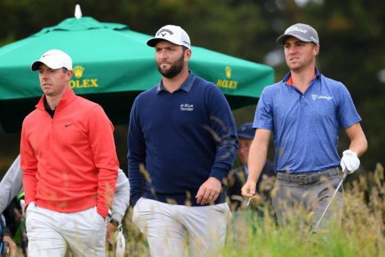 The banner group (L-R) Rory McIlroy, Jon Rahm and Justin Thomas.