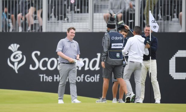 Robert MacIntyre (L) played with Lee Westwood at the Scottish Open last week.