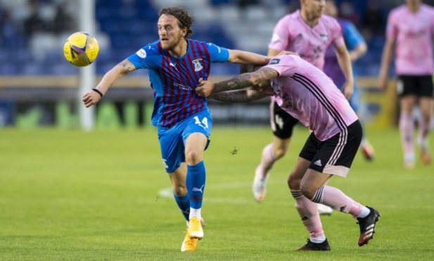 Tom Walsh in action for Inverness.