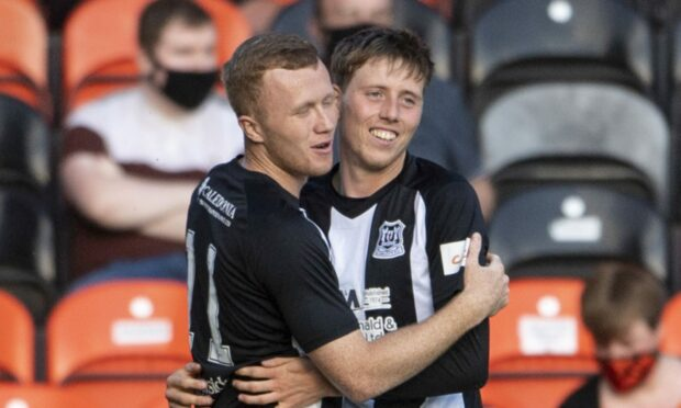 Elgin City striker Kane Hester, right, celebrates his goal against Dundee United with Connor O'Keefe.