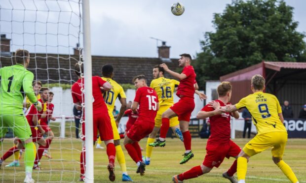 Ross County's Alex Iacovitti heads home from a corner to make it 1-0 at Brora Rangers.