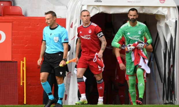 Aberdeen captain Scott Brown leads his side out to face BK Hacken.