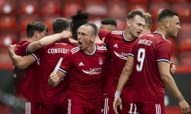 Aberdeen captain Scott Brown (centre) celebrates Andrew Considine's opener.