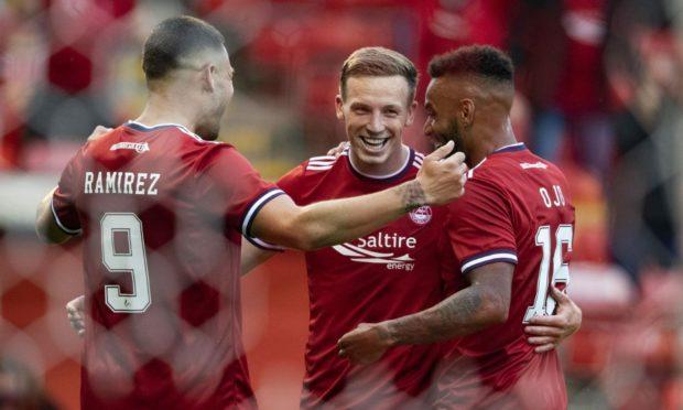 Celebration time. Aberdeen's Lewis Ferguson (centre) celebrates his second goal against BK Hacken.