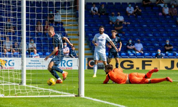 Blair Spittal slots the ball past Montrose goalkeeper Aaron Lennox.