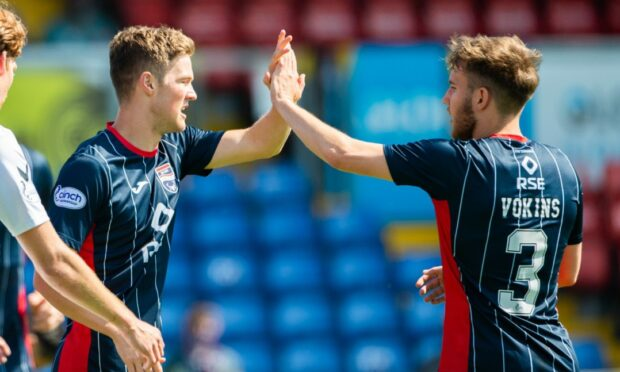 Blair Spittal (left) celebrates his goal to make it 4-0 against Montrose.
