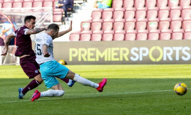 Jamie Walker smashes home Hearts' winner against Caley Thistle.