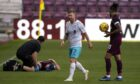 Michael Gardyne leaves the pitch after being red carded against Hearts.