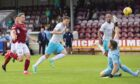 Shane Sutherland clips the ball over Arbroath keeper Derek Gaston to seal a 1-0 Inverness win.