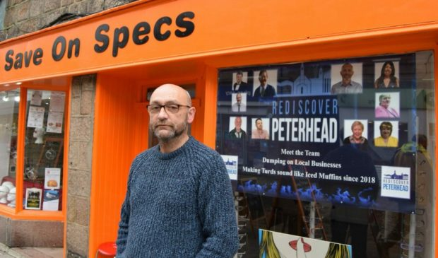 Keith Bennett outside his glasses shop, now called Spex Shop. He is offering business owners who vote down the renewal of the Peterhead Bid £100 store credit.