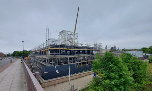 Contractors are working around the clock to create a new 175-bed hotel on the banks of the Ness.