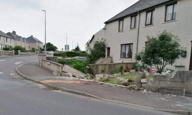 A car crashed into a garden wall following a police chase in Shetland.